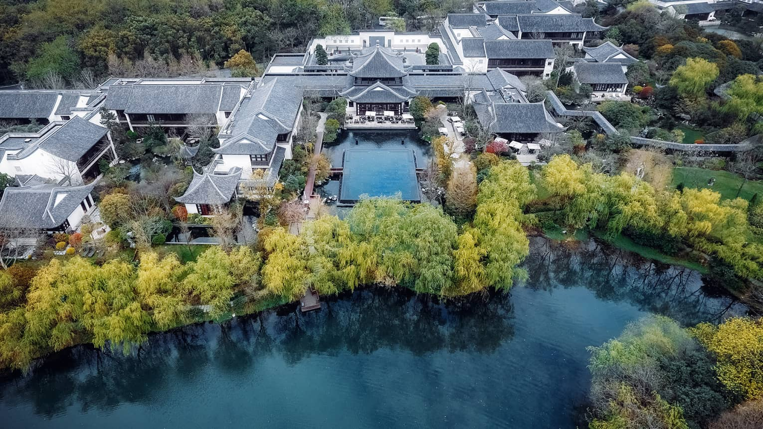 Aerial view of Four Seasons Hotel Hangzhou village-like resort on water