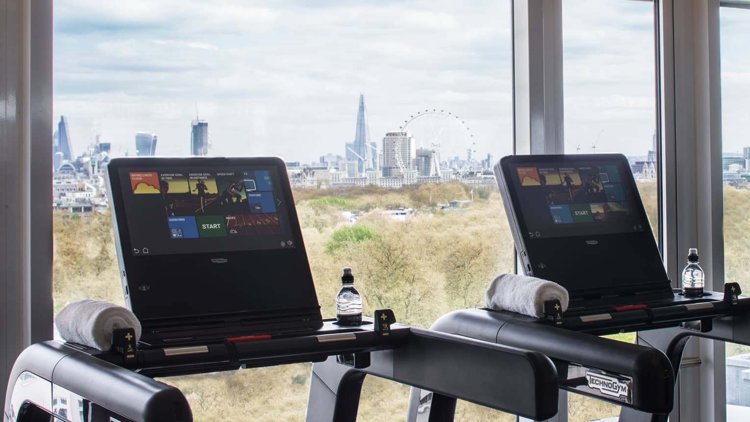 Treadmills along sunny window it Fitness Centre