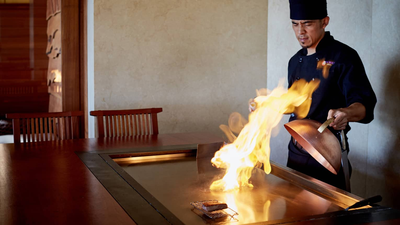 Flames shoot up from grill as NOBU restaurant chef pulls back copper lid