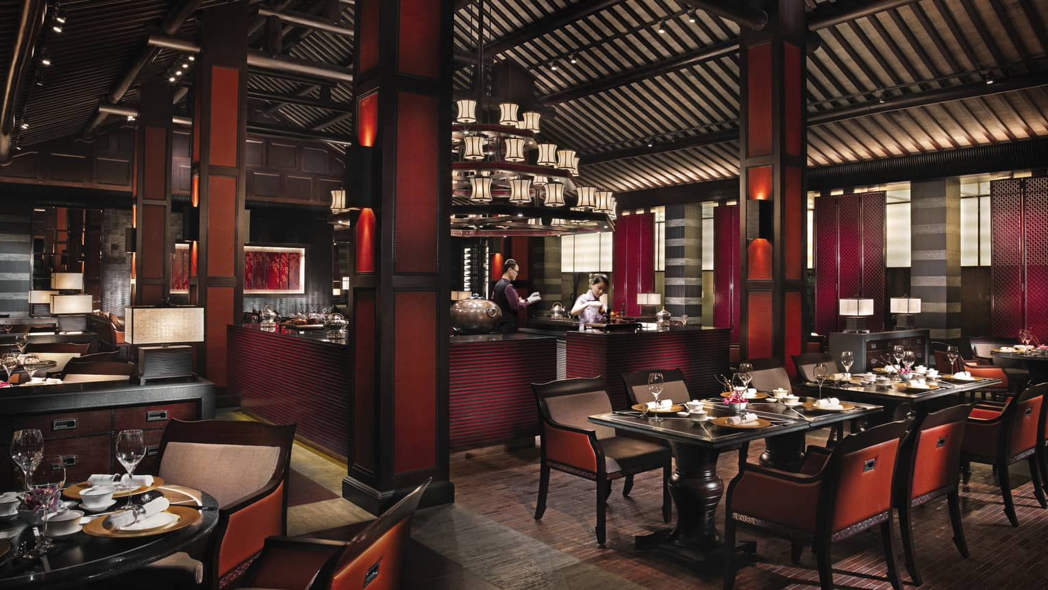 Jin Sha dining room with dark red-and-black decor