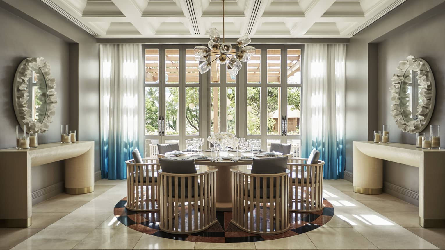 Modern wood chairs around table, glass lantern chandelier in Noe private dining room