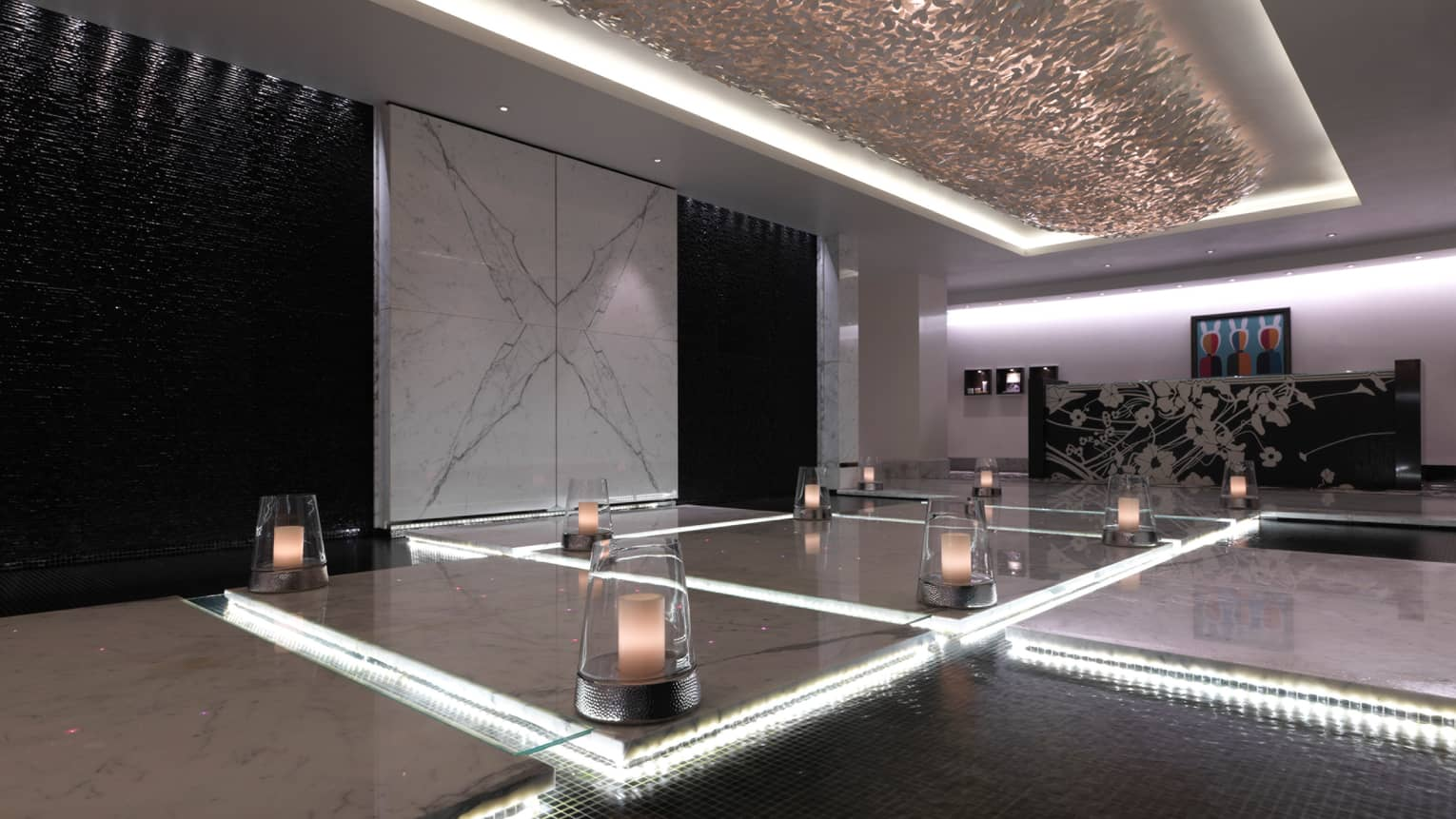 Glowing candles under glass domes placed around black-and-white marble floor