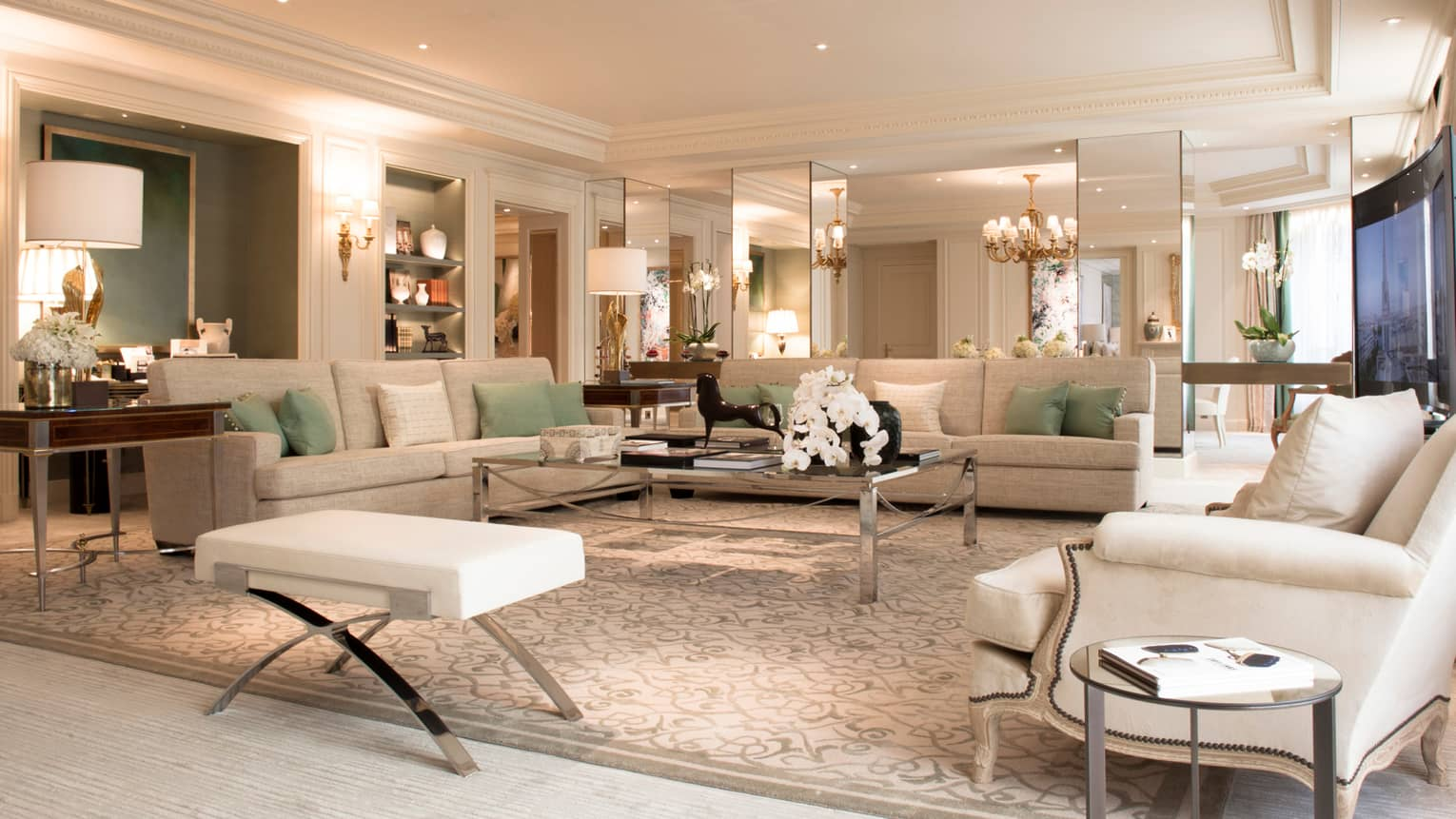 Royal Suite large living room, white sofas, armchairs, lamps, mirror walls