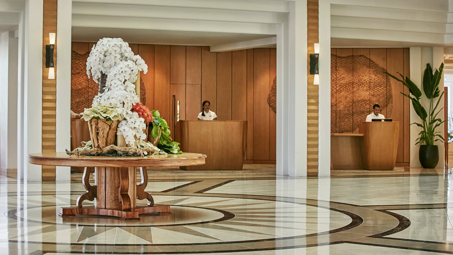 Four Seasons Oahu hotel lobby with desk, tropical flowers on large round table