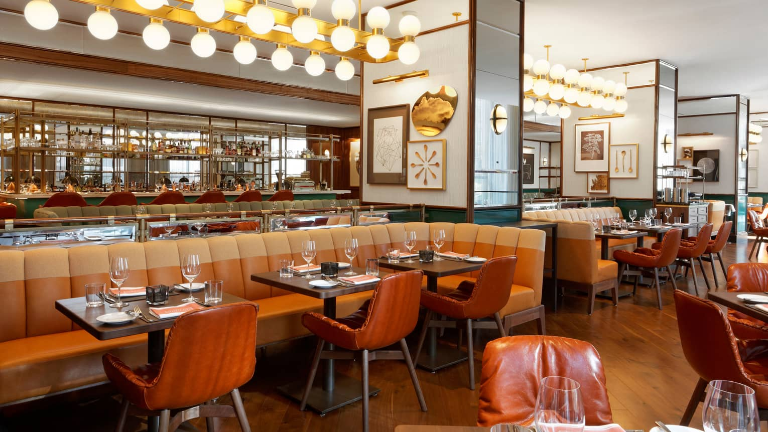 Cafe Boulud orange leather chairs, long banquette under row of globe lights