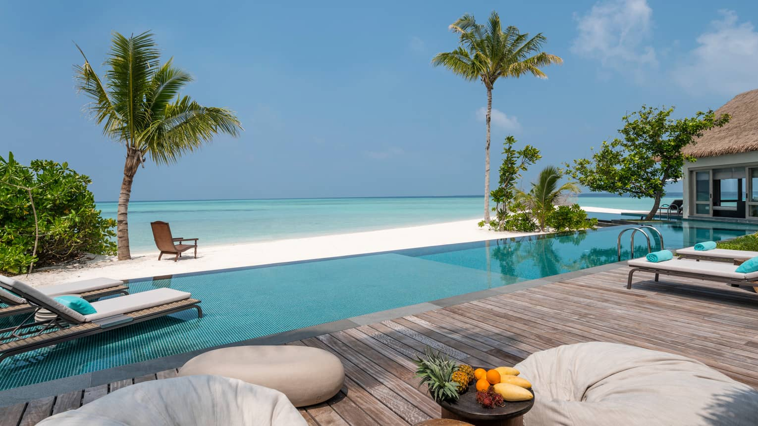 Three-Bedroom Beach Villa fresh fruit on platter on deck by swimming pool, beach