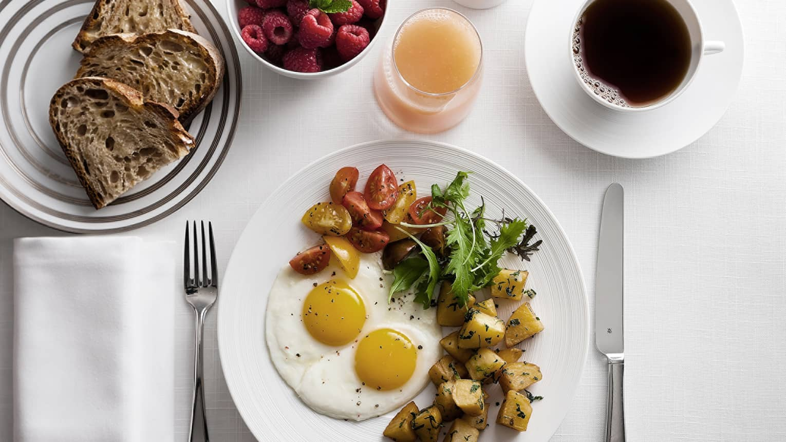 In-bungalow dining breakfast with sunny side egg, roast potatoes and salad, toast, coffee and fresh fruit