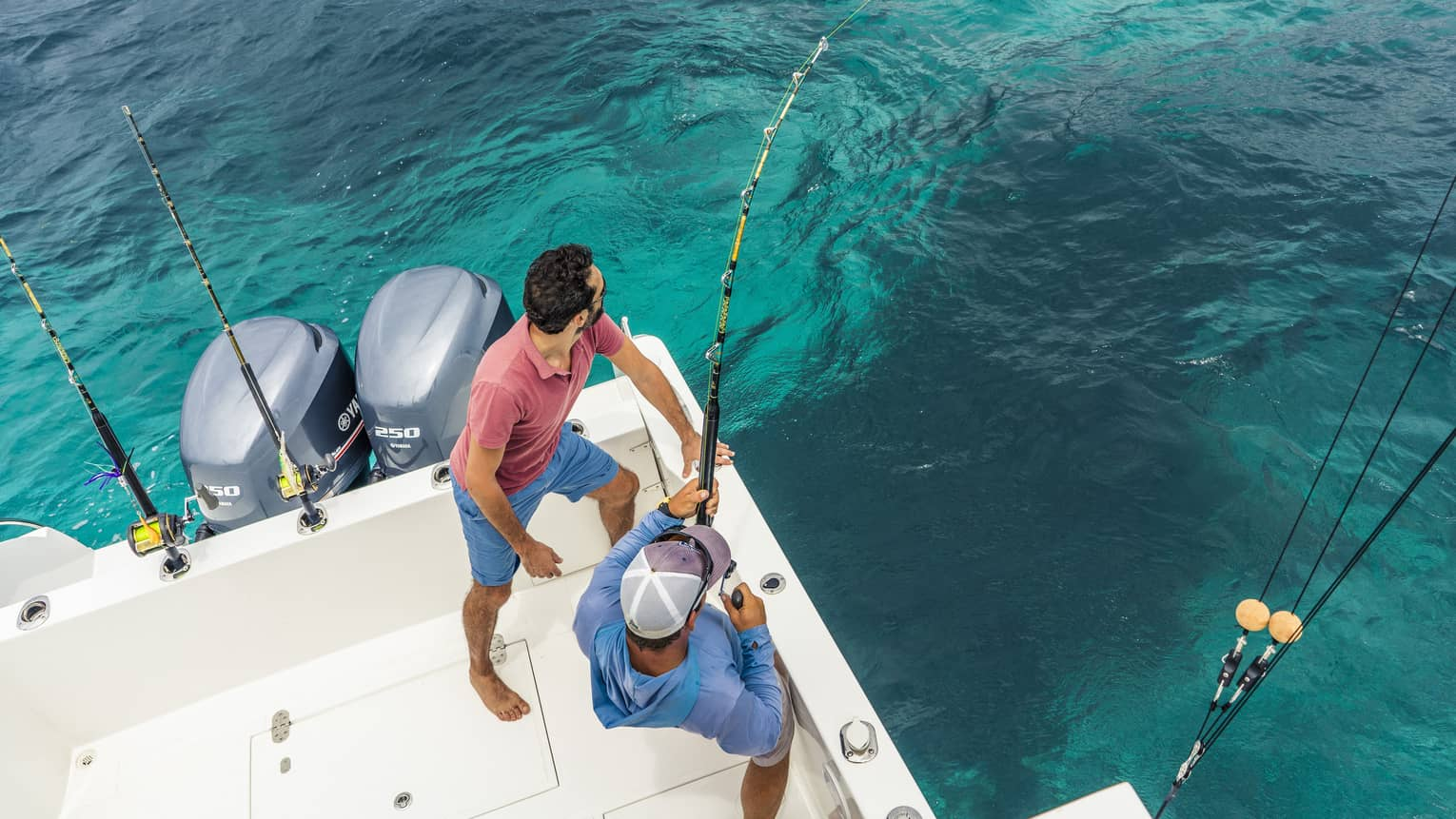 Two men deep sea fishing.
