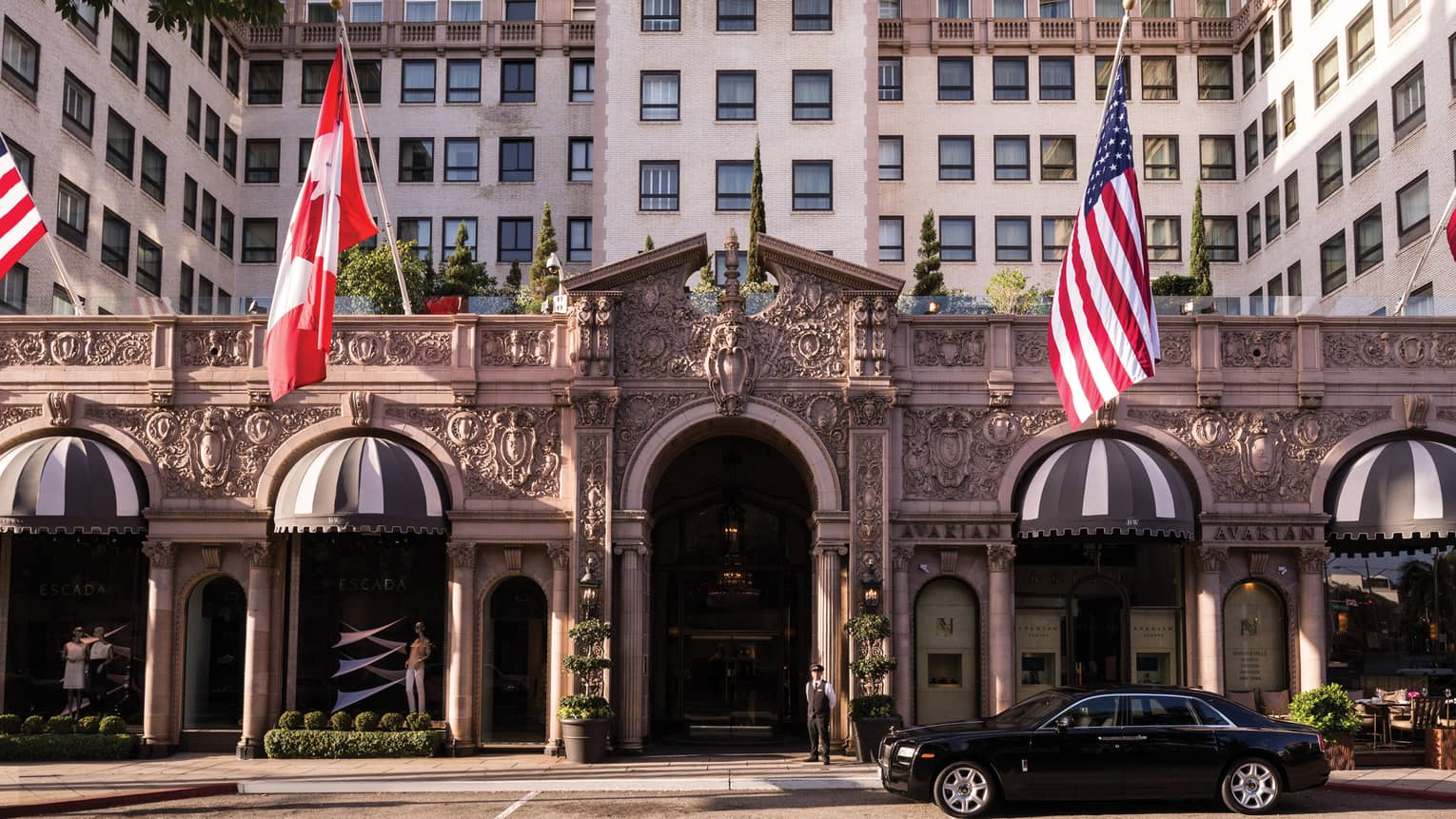 Beverly Wilshire, A Four Seasons Hotel grand front entrance with American, Canadian flags