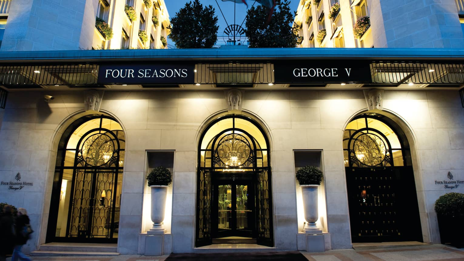 Four Seasons George V entrance with arched glass, iron doors