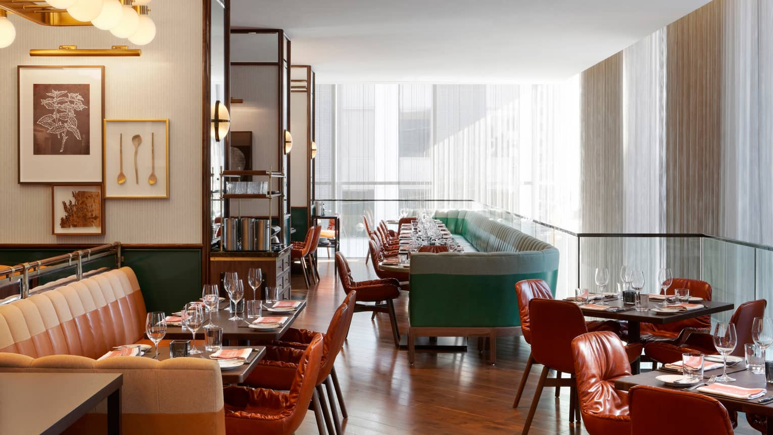 Café Boulud sunny dining room with leather seats and banquettes. tables, white curtains
