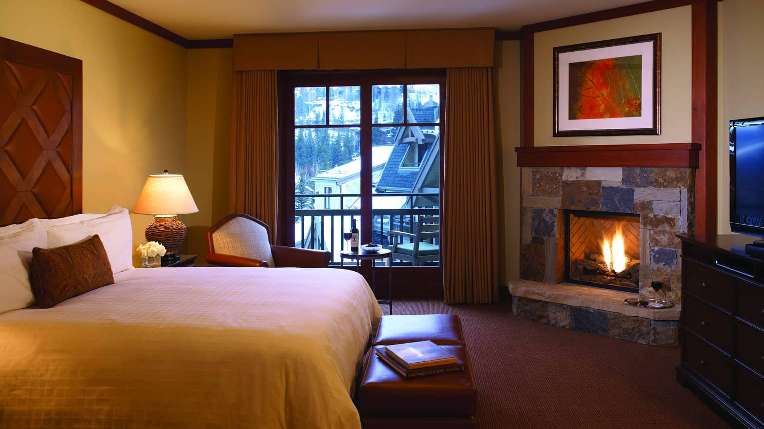 A fire in the fireplace warms the Mountain View Room at Four Seasons Vail
