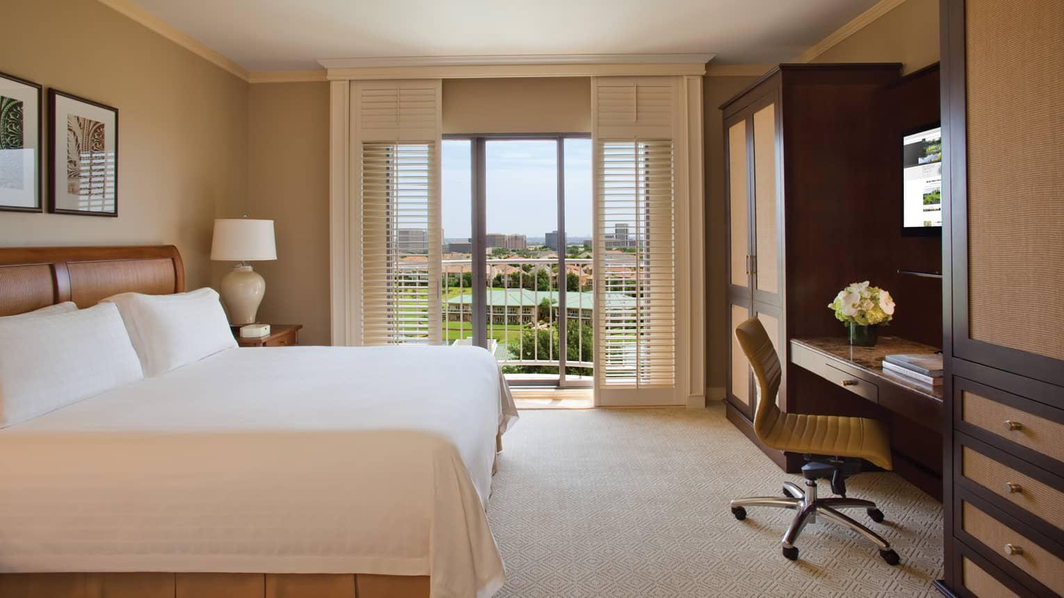 Premier Tower Golf-View Room bed across from desk, chair, white shutters opening to balcony
