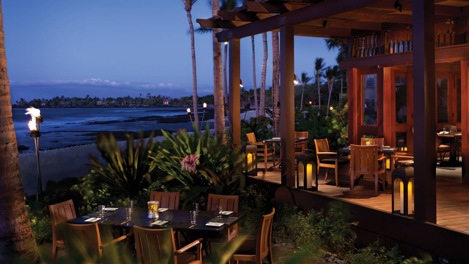 ULU Sushi Lounge dining patio near beach at dusk