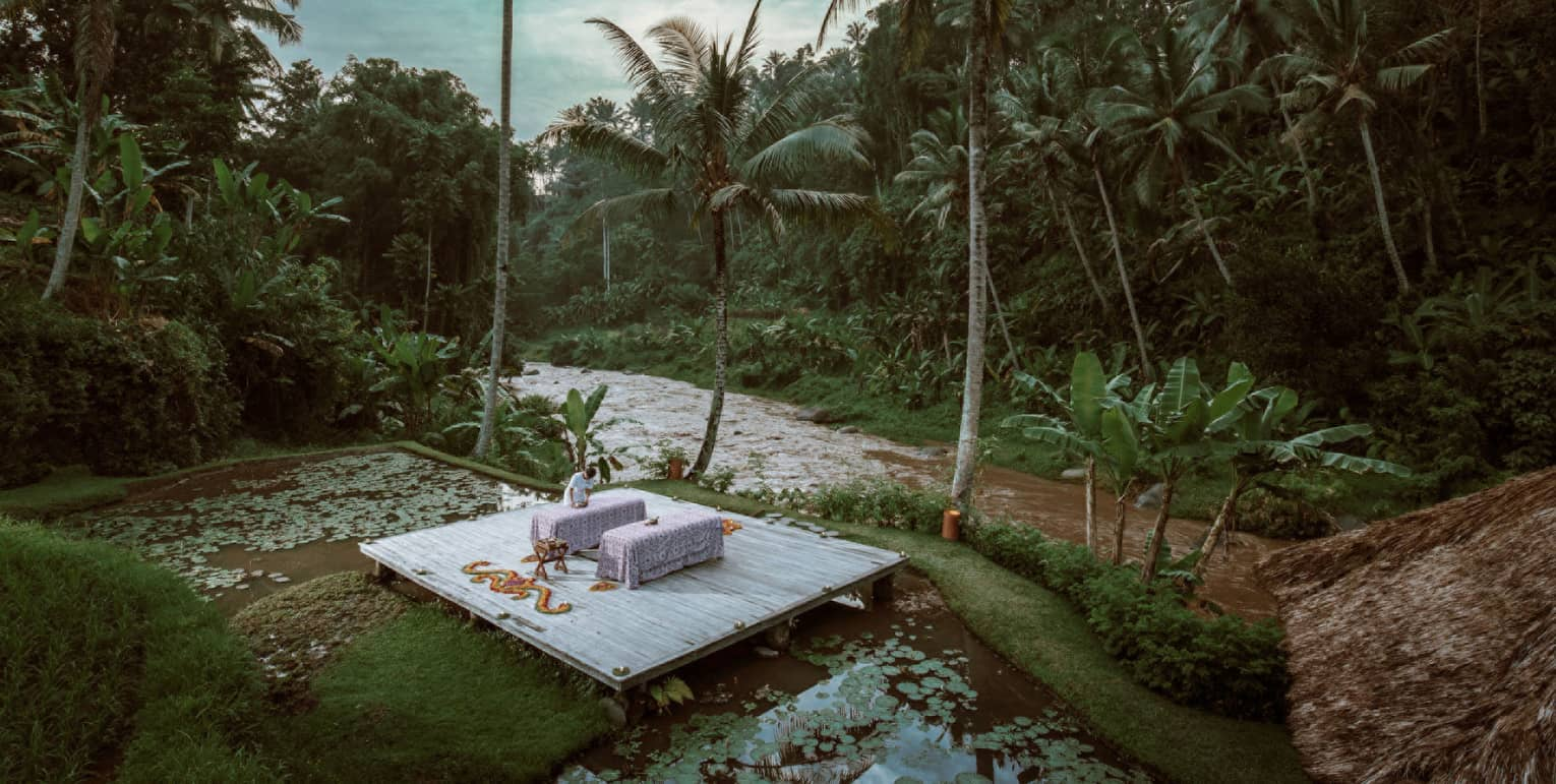 A nighttime spa treatment next to a river in Bali