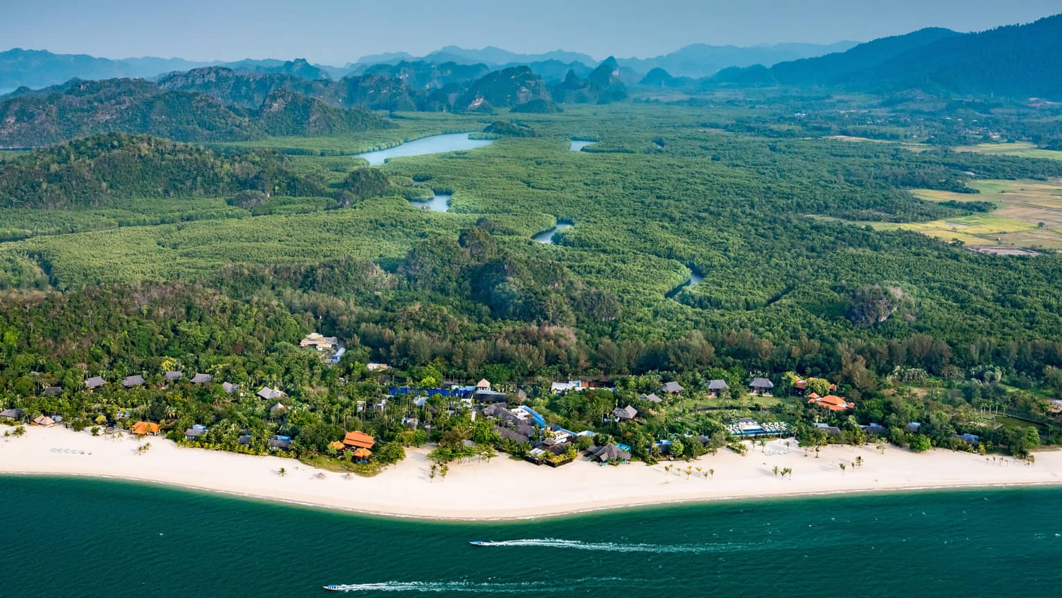 Aerial view of Four Seasons Langkawi Malaysia resort coastline, rainforest