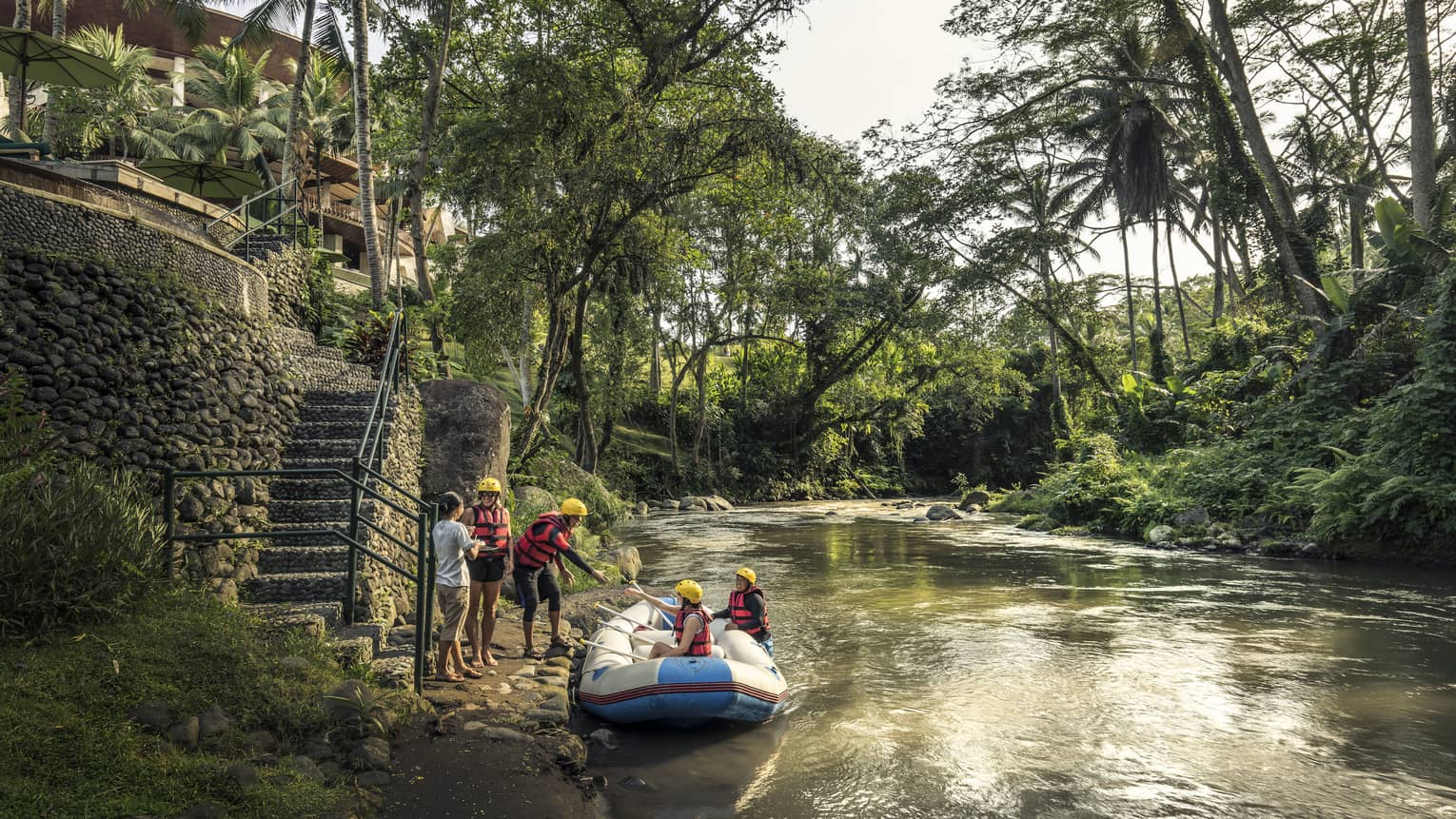 Guests disembarking from a raft after a river adventure in Bali