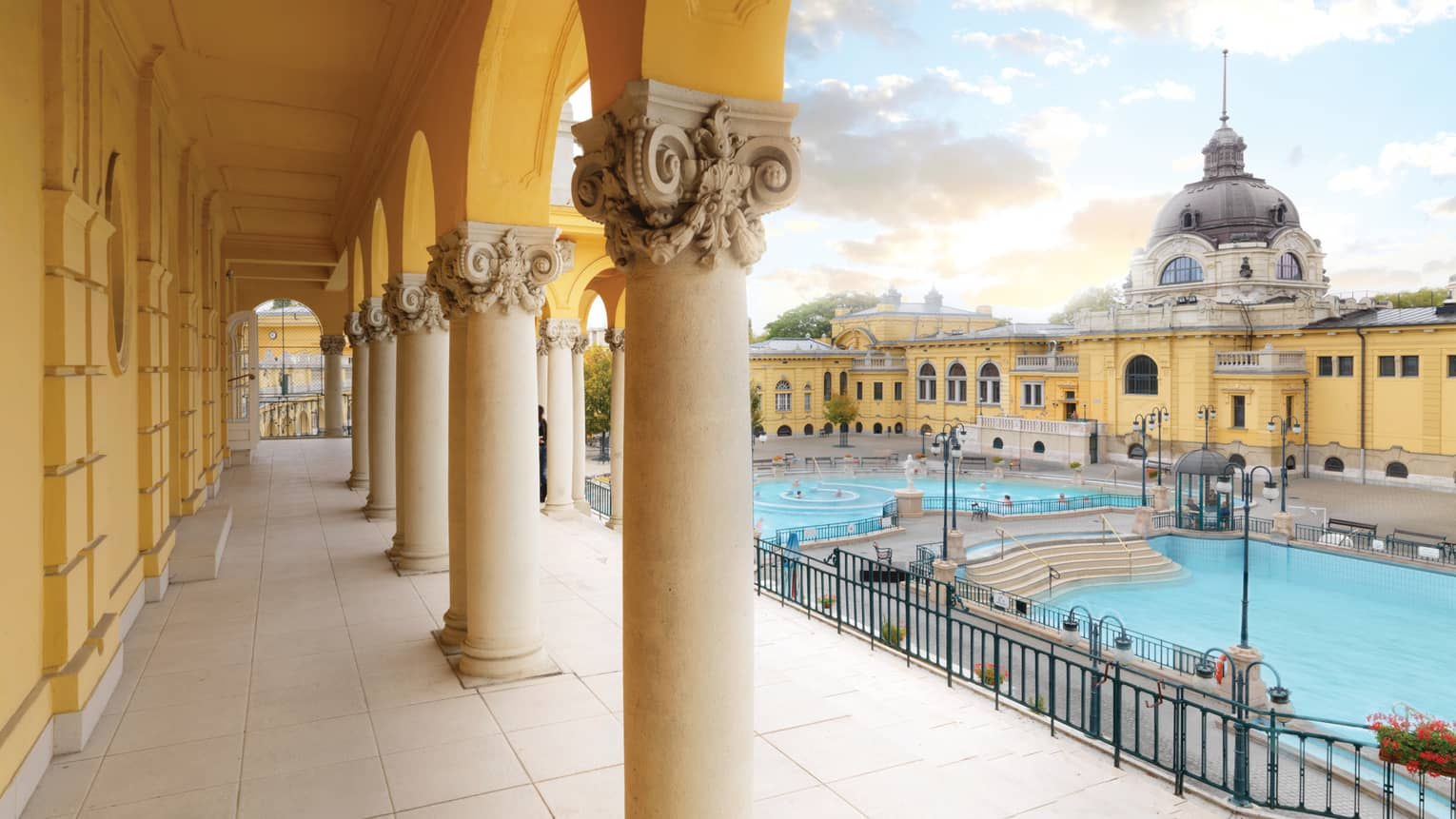 The Széchenyi Thermal Bath pools surrounded by historic building, pillars