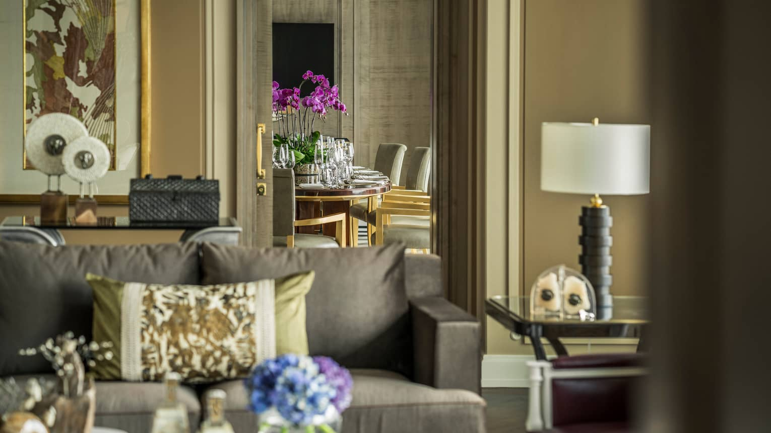 Presidential suite living space with flower arrangement