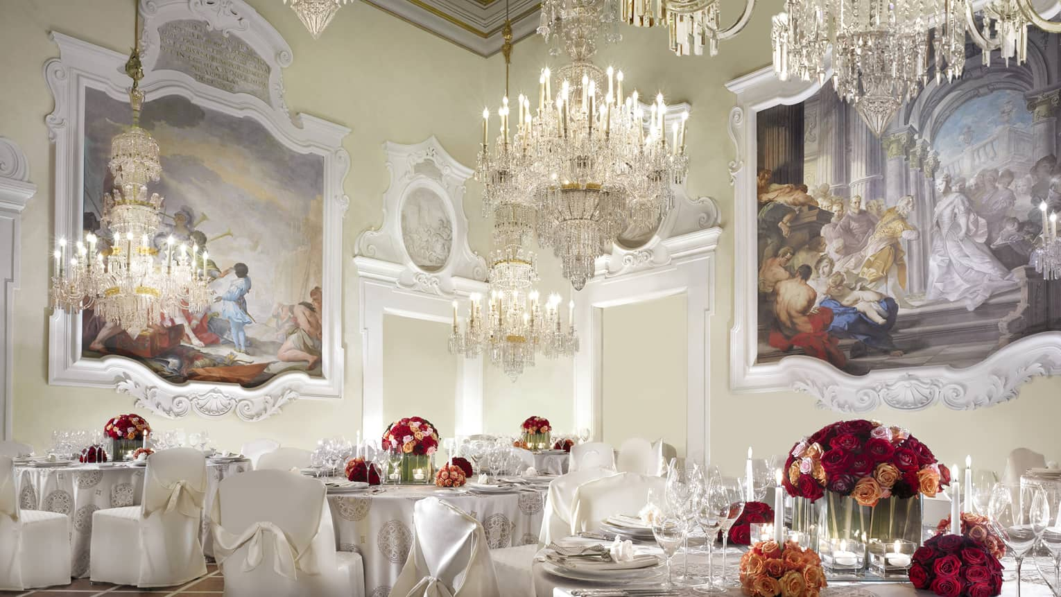 Gherardesca ballroom with large crystal chandeliers, paintings over elegant banquet tables