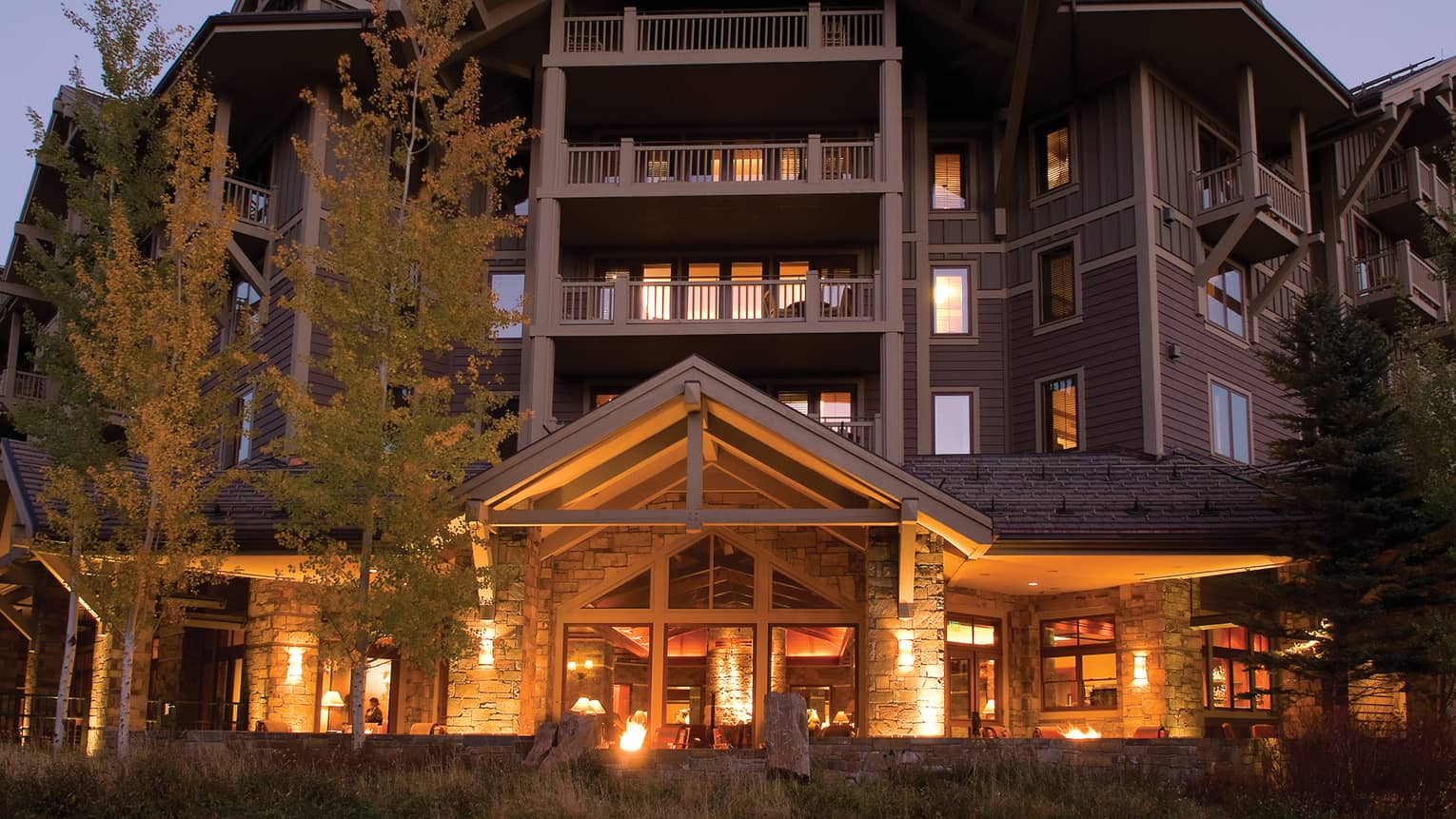 West side exterior view of Four Seasons Resort Jackson Hole at dusk