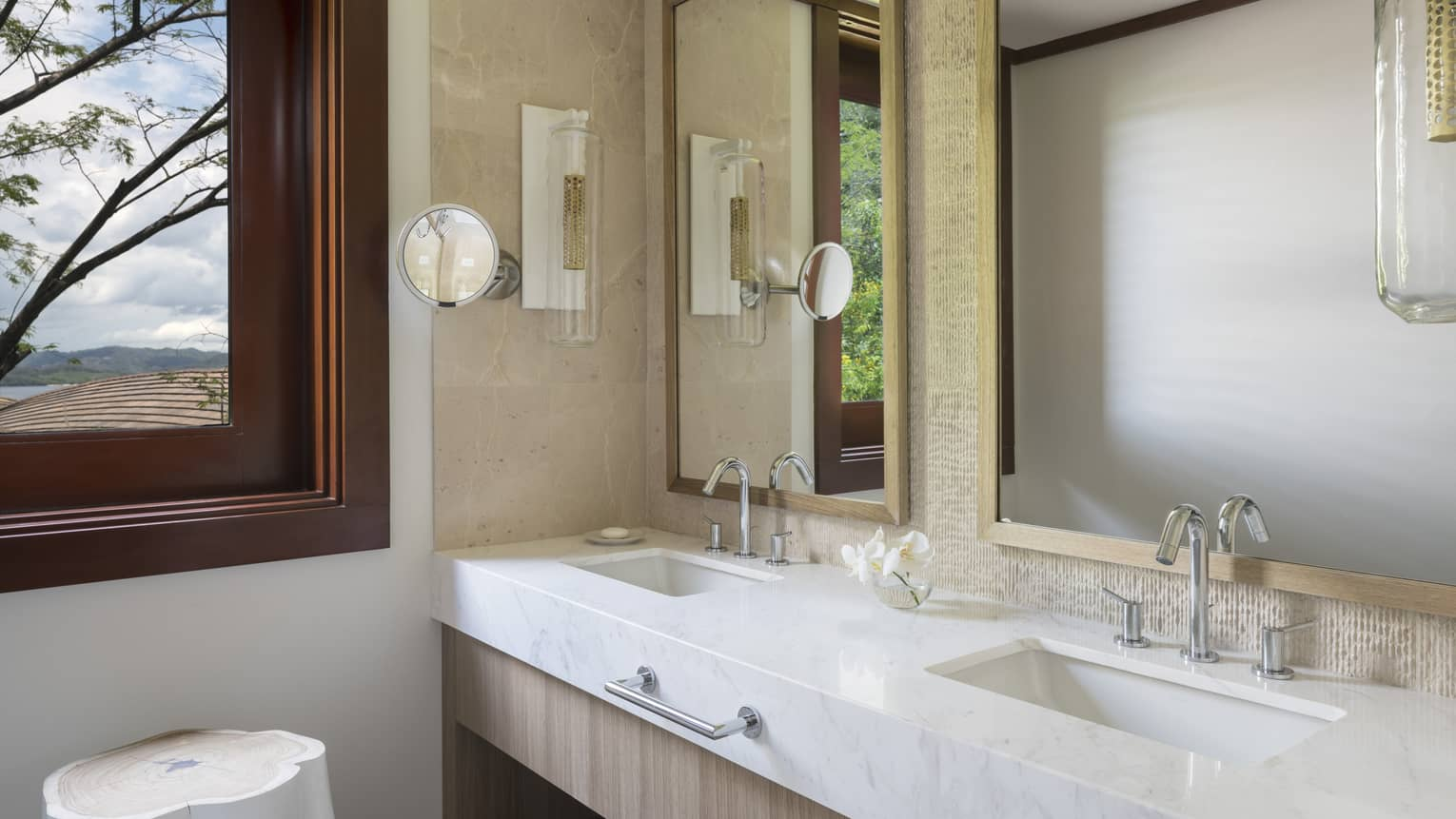 Bathroom View of Sinks and Mirrors with Window