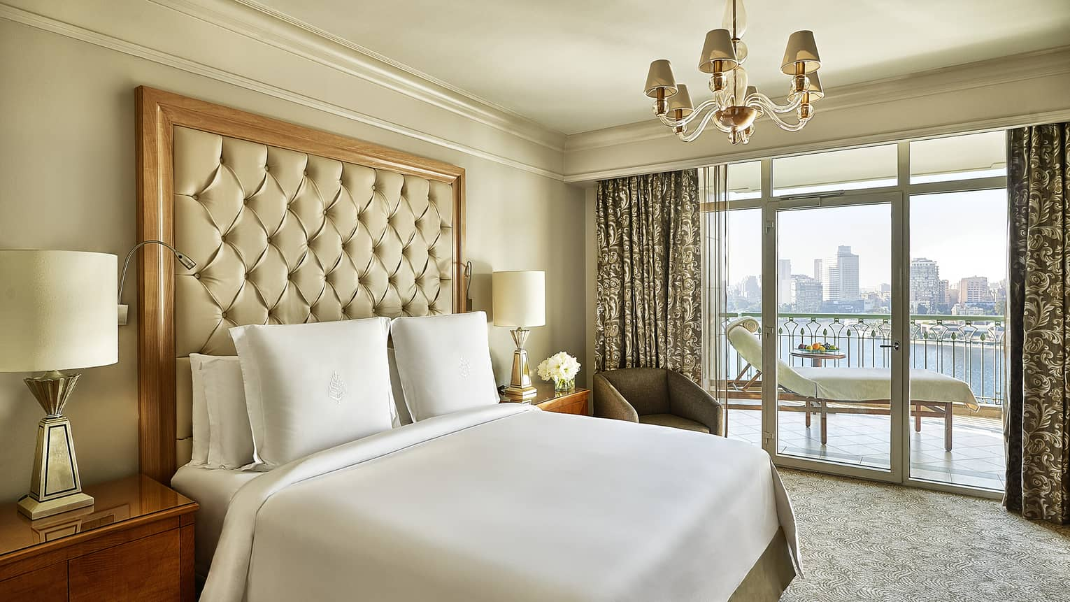 Four Seasons Suite, showing white-dressed bed and city views from windows