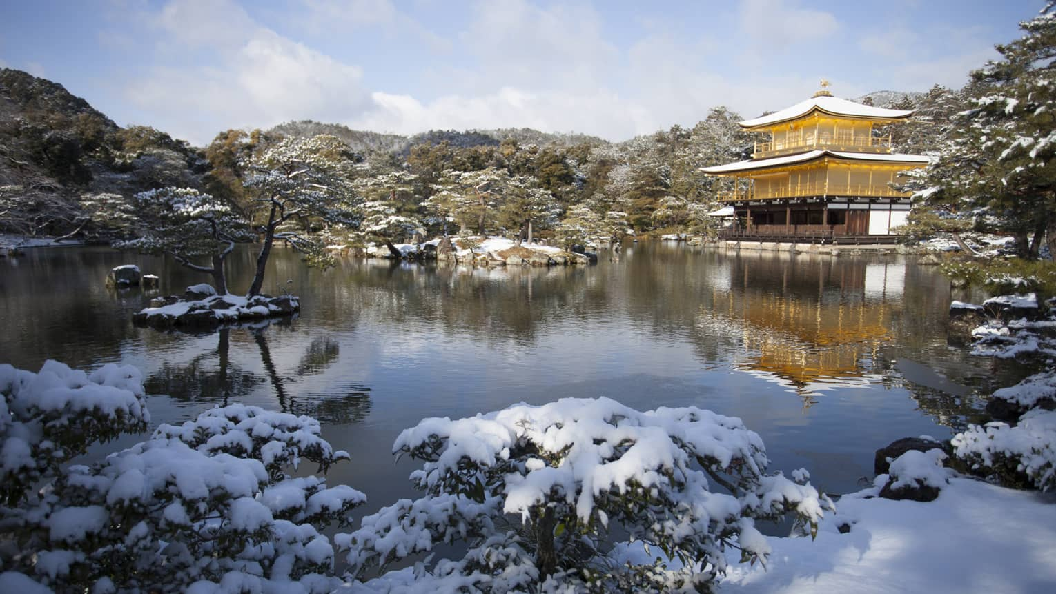 Golden Temple in Kyoto Japan covered with snow by the lake