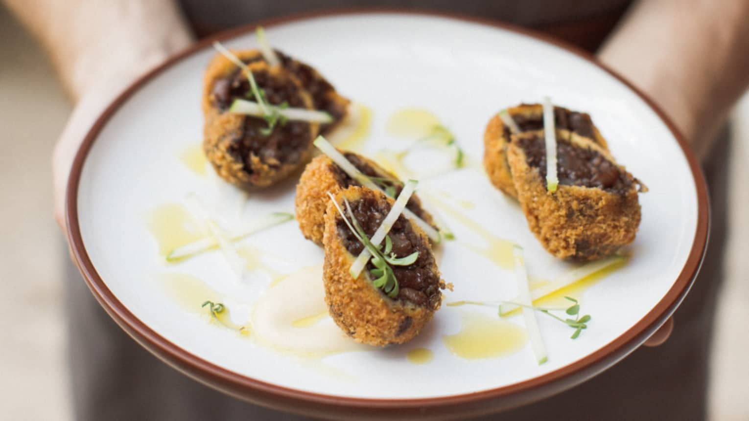 Blood sausage croquets are served with green apple