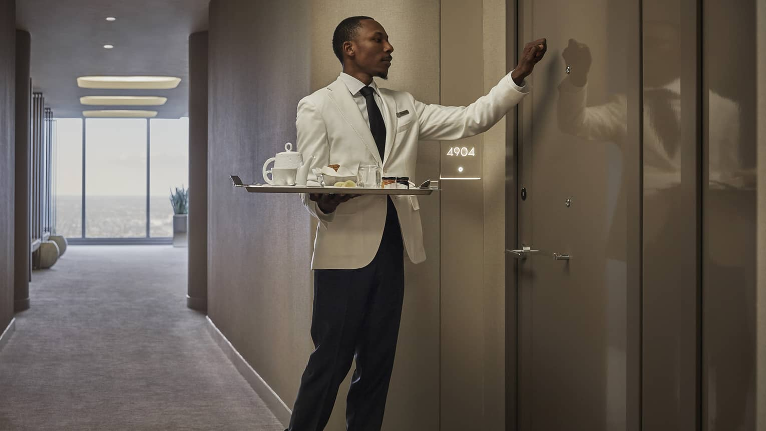 A Four Seasons staff delivers room service to a guest room at Four Seasons Philadelphia