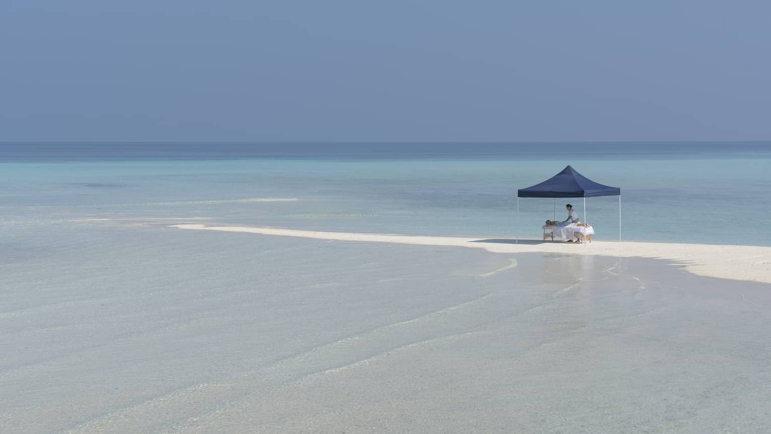 A guest receives a massage at the Sandbank Spa
