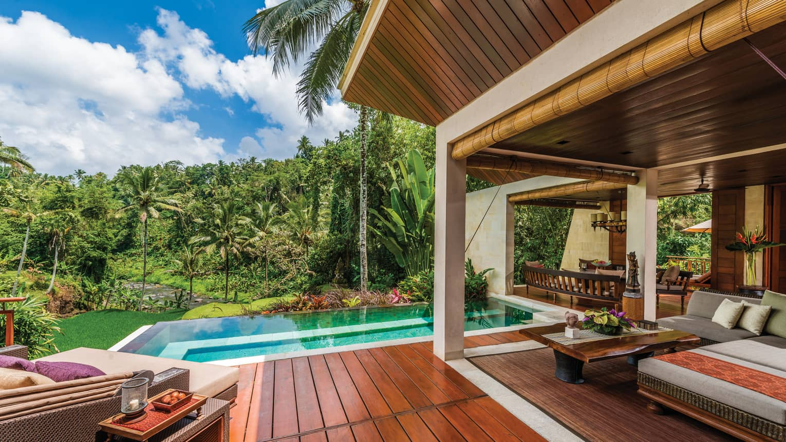 River-View Two Bedroom Villa patio with wood deck, blue plunge pool, large patio sofas with cushions, forest views