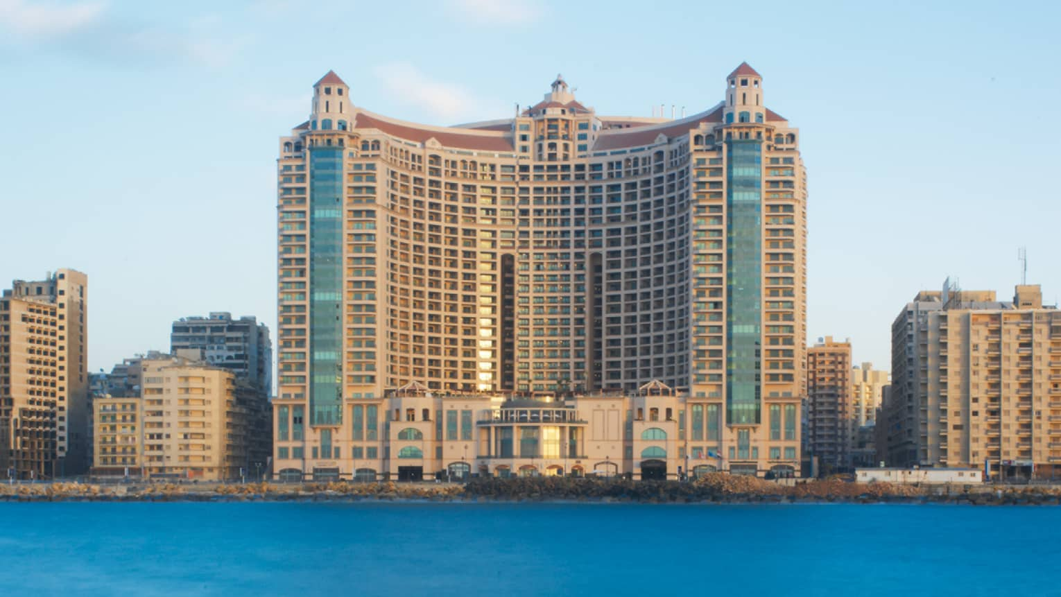 Exterior of Four Seasons Hotel Alexandria at San Stefano, Egypt, on sunny day from Mediterranean Sea