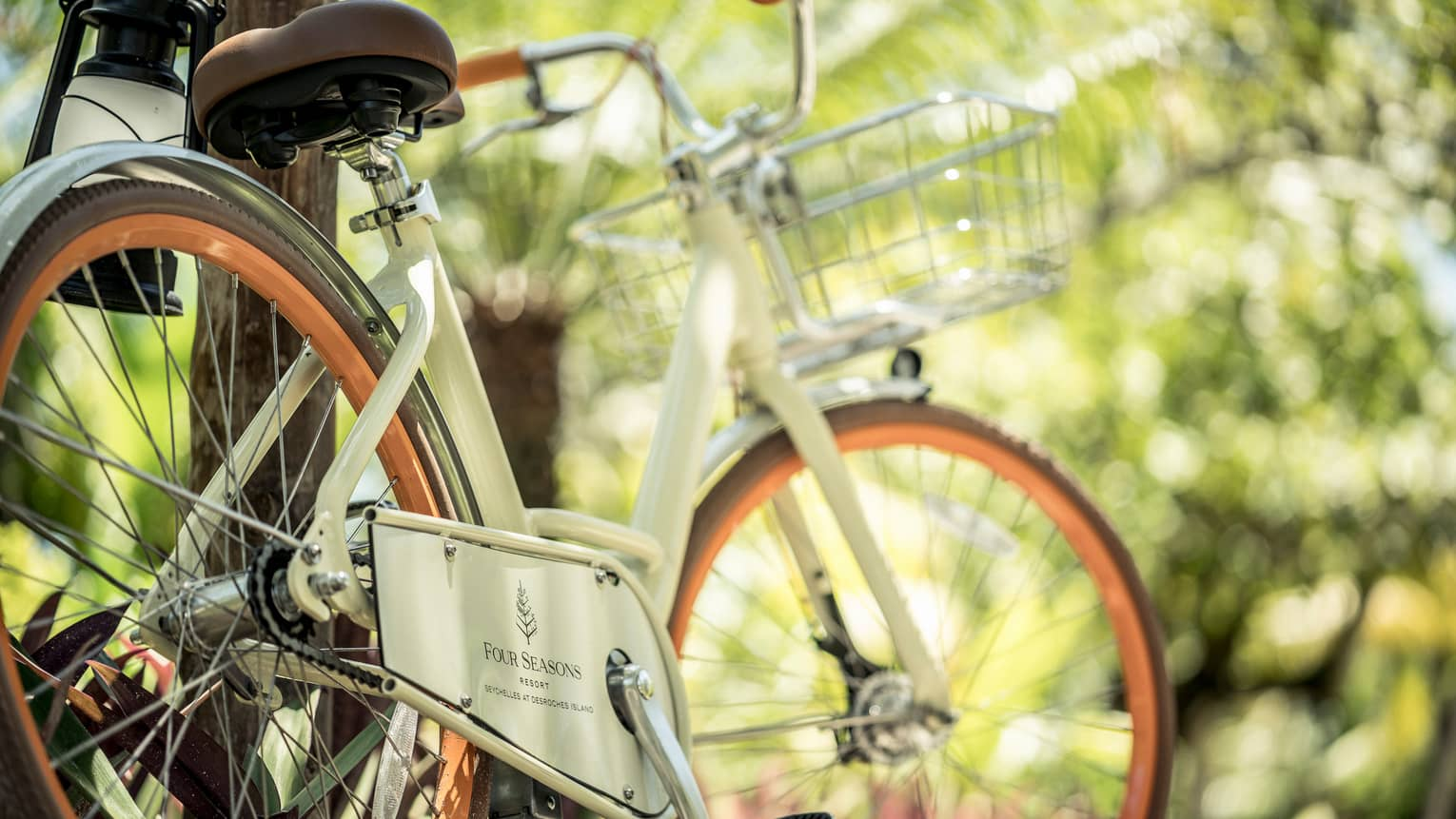 White vintage style bicycle with Four Seasons Hotels logo