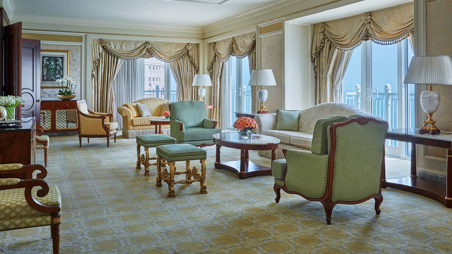 State Suite large living room with gold accents, antique-style sofas, curtains
