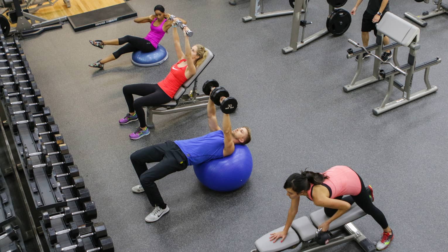 People lift weights, do sit ups in Fitness Centre