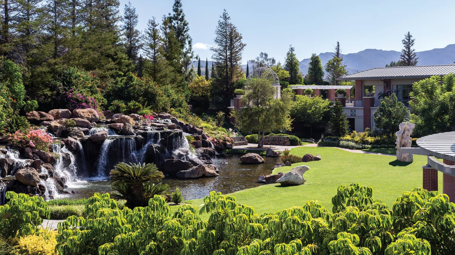Waterfalls over rocks, boulders in garden at Four Seasons Hotel Westlake Village
