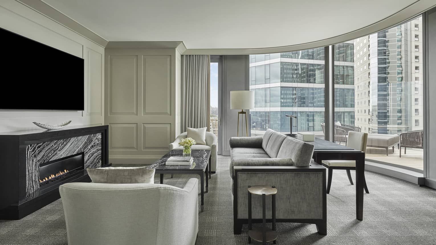 The guest sitting area in the charles suite opens to an outdoor terrace, overlooking downtown boston