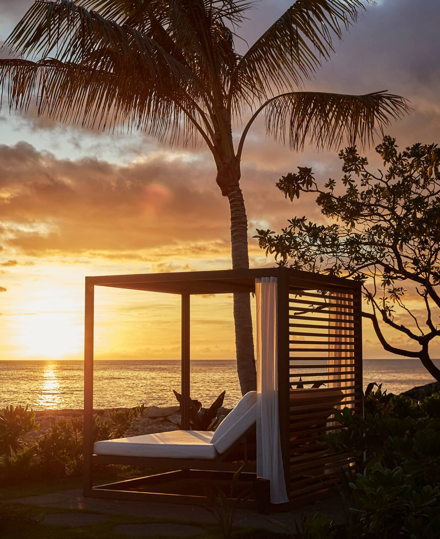Daybed overlooking the beach during sunset