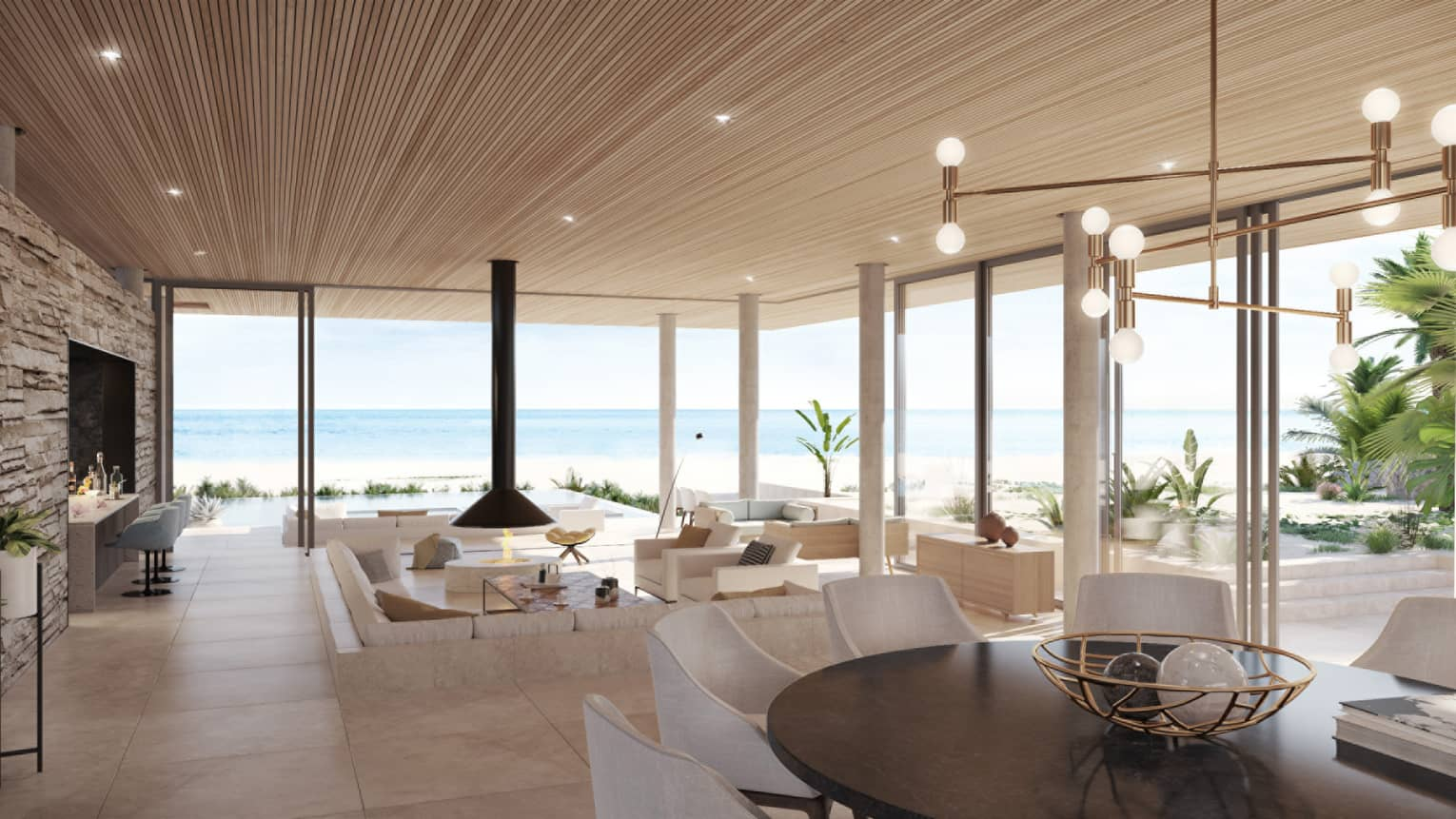Bright, modern living room with tile floors, sunken living room, floor-to-ceiling windows overlooking beach