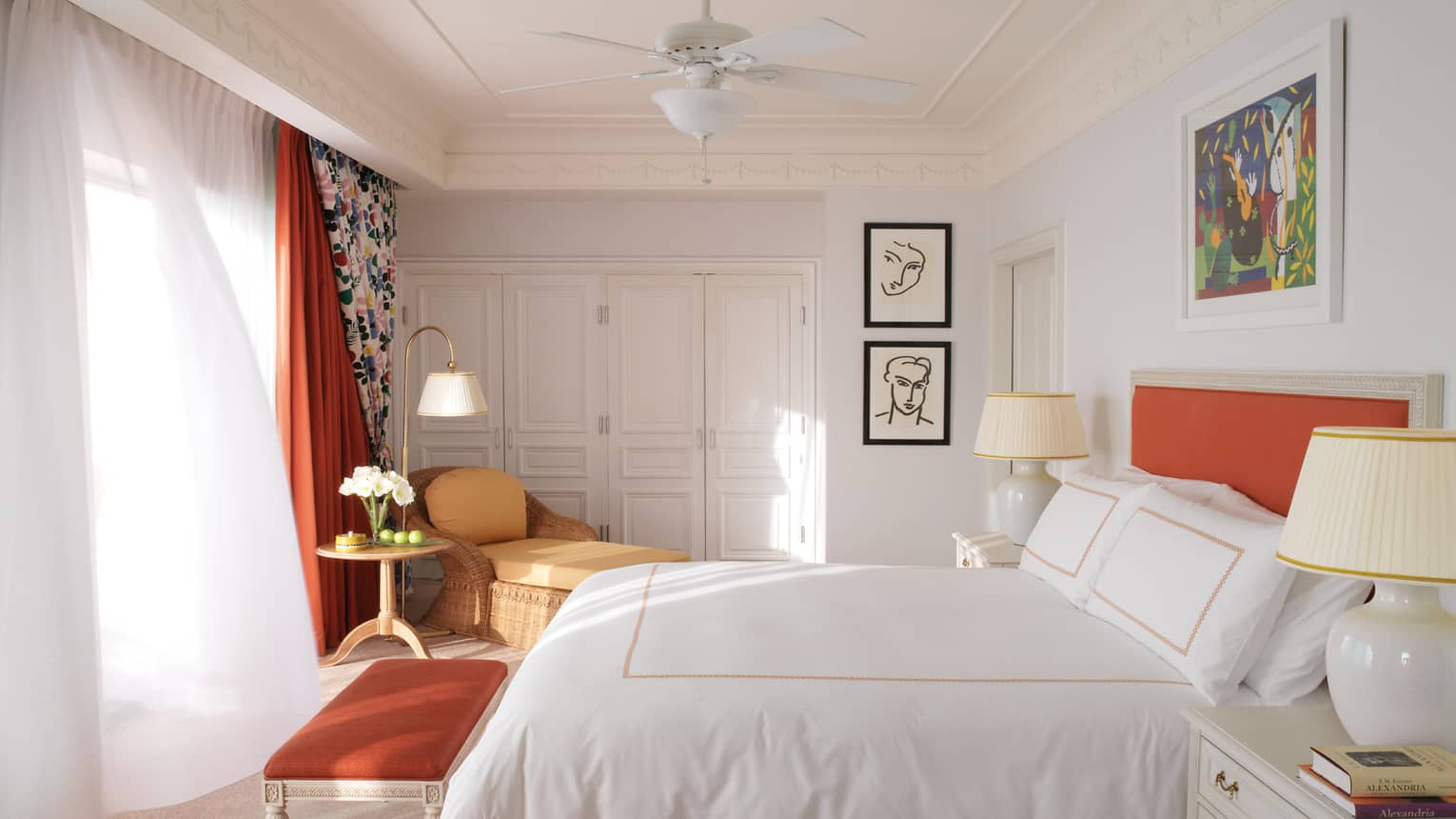 Bright Pool Terrace Room with white walls, bed linens, curtains, orange accent colours