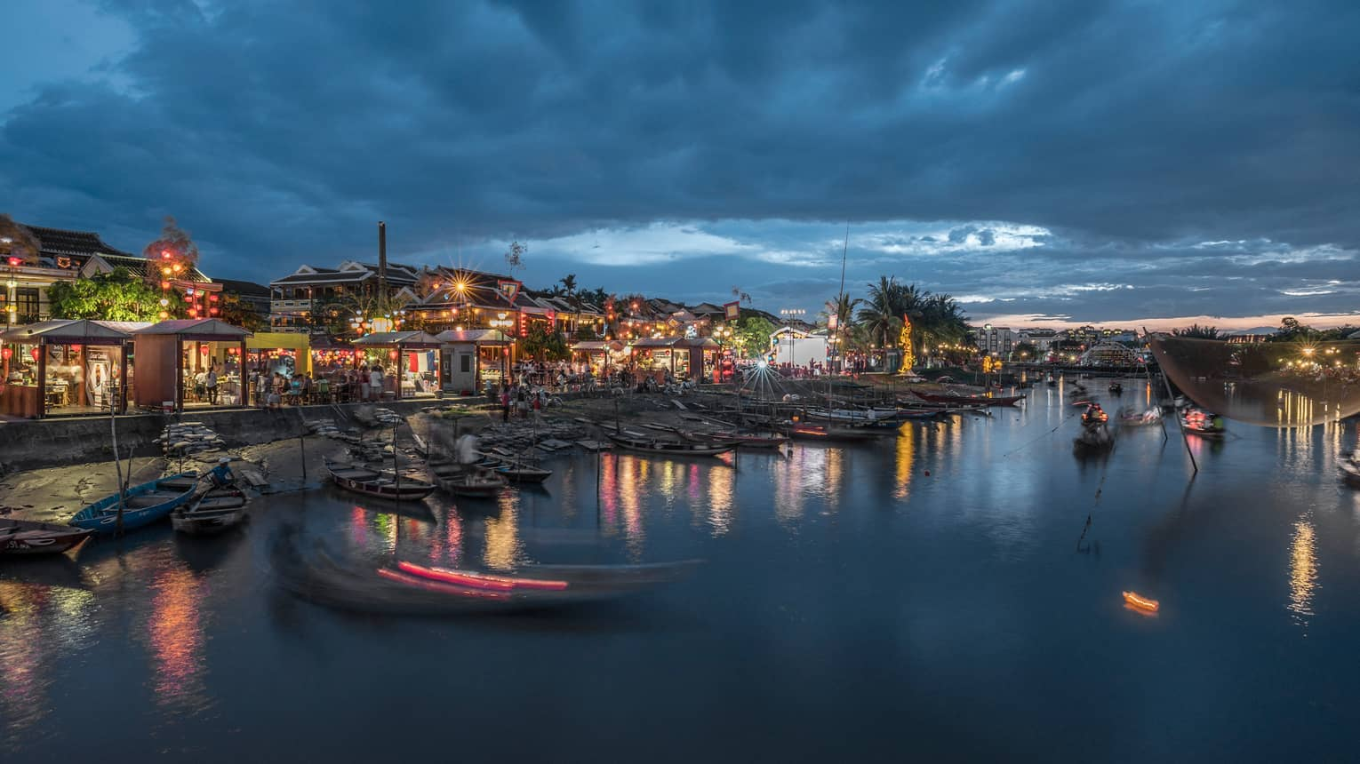 Colourful lights around buildings, markets on Hoi An waterfront at night