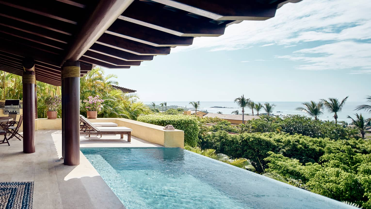 Savour the year-round sunshine by your private pool, with privileged ocean views in every direction