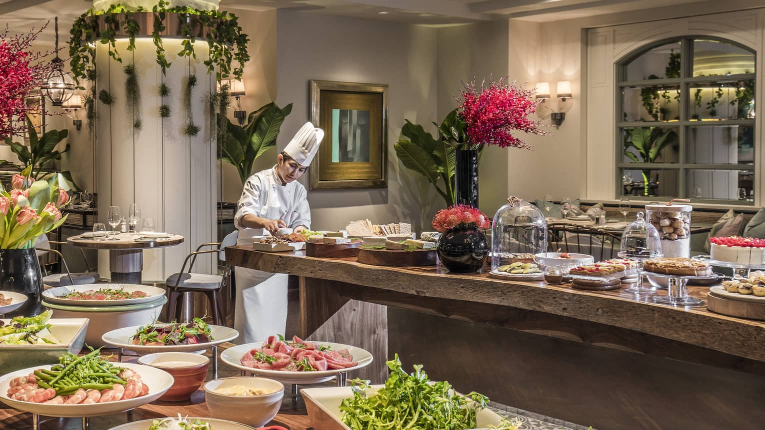 A lunch buffet arranged with platters of seafood, fresh vegetables and a large variety of other options at the One Ninety Restaurant