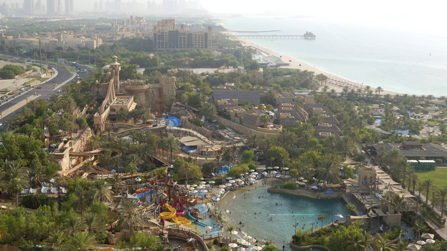 Aerial view of Wild Wadi Waterpark with waterslides, Dubai skyline visible