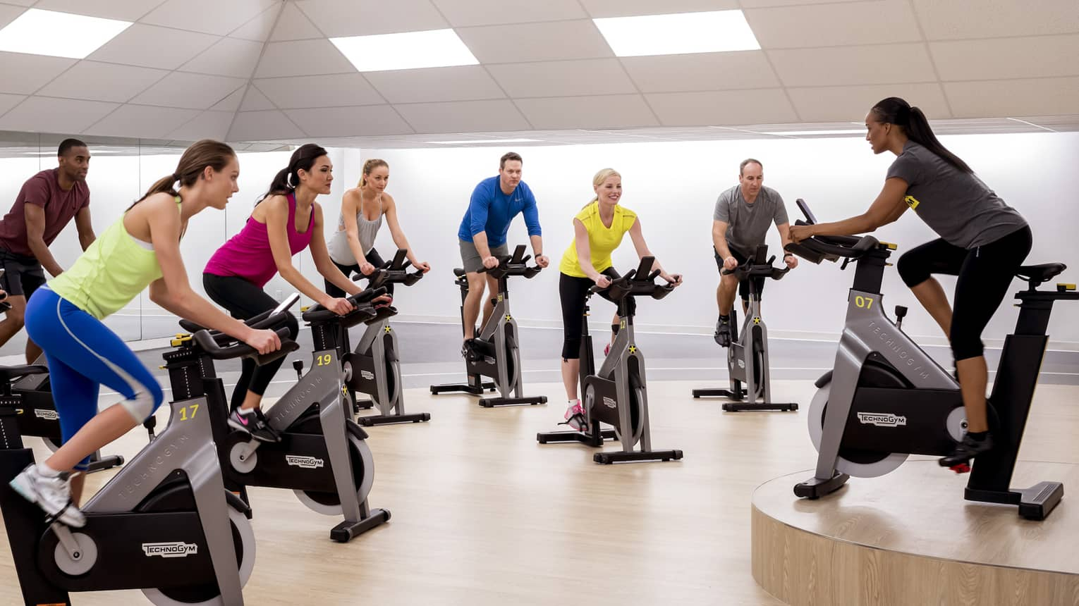 People workout on cardio spin bike machines in Fitness Centre