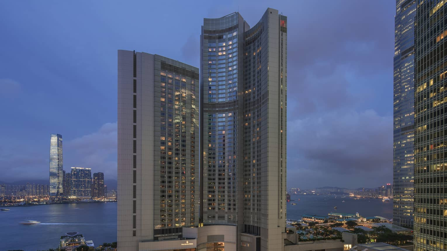 Four Seasons Hotel Hong Kong high rise exterior at dusk