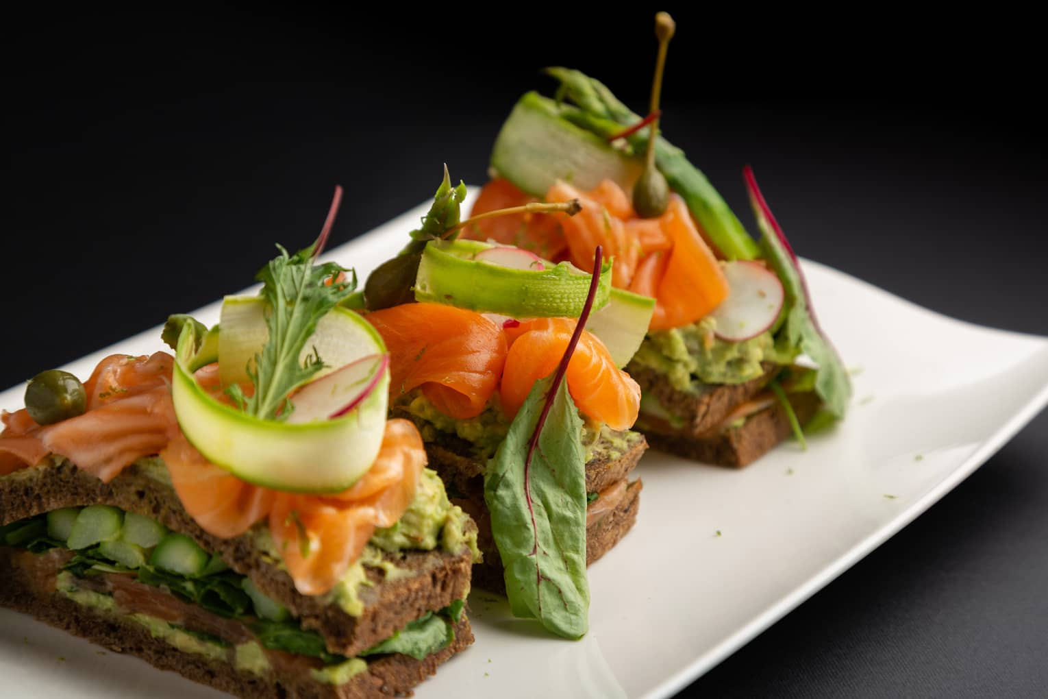 Scottish smoked salmon club sandwich with avocado, sucrine lettuce and radish