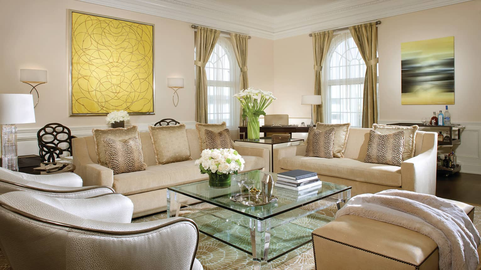 Wilshire Presidential Suite ivory sofas, silk armchairs around glass table with martinis, flowers