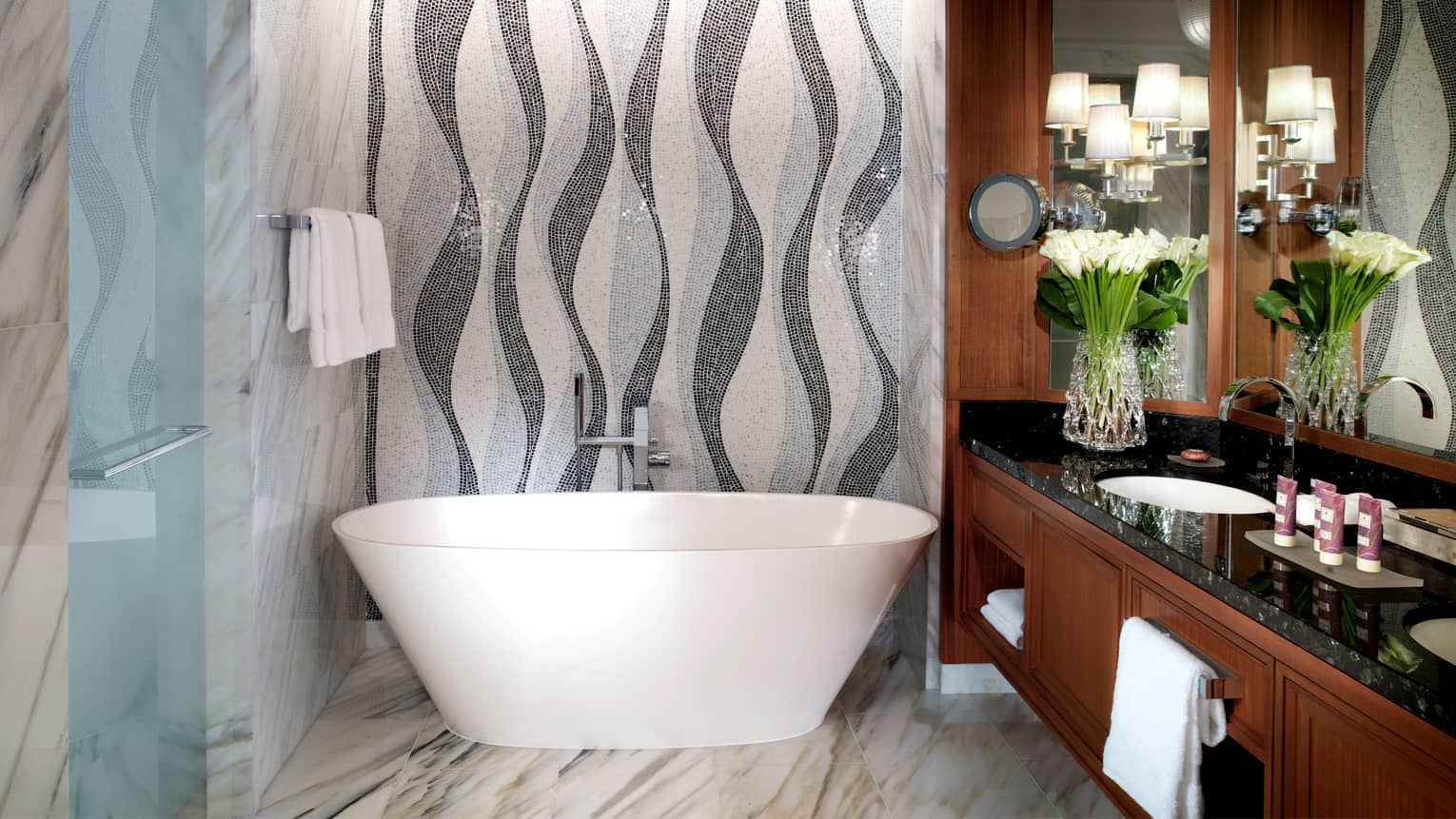Imperial Suite marble bathroom with free-standing white soaker tub, double sink